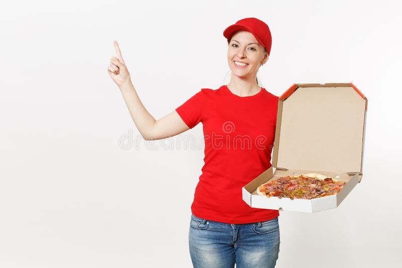 Delivery woman in red uniform isolated on white background. Pretty female in cap, t-shirt, jeans working as courier or. Dealer holding italian pizza in stock photography