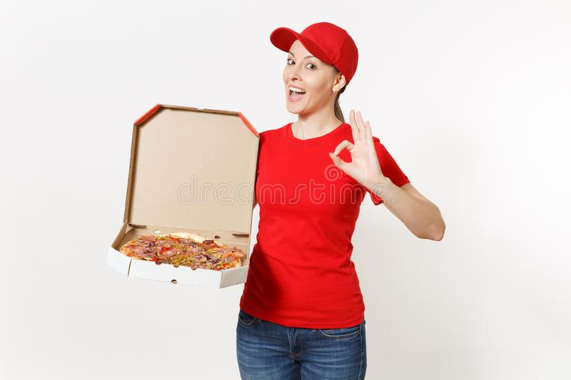 Delivery woman in red uniform isolated on white background. Pretty female in cap, t-shirt, jeans working as courier or. Dealer holding italian pizza in royalty free stock photo
