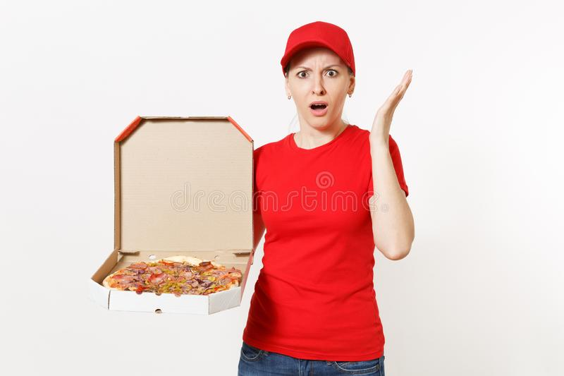 Delivery woman in red uniform isolated on white background. Pretty female in cap, t-shirt, jeans working as courier or. Dealer holding italian pizza in stock images