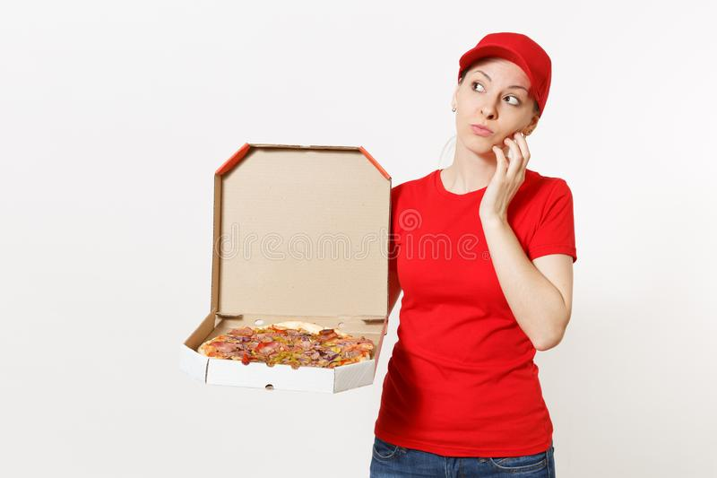 Delivery woman in red uniform isolated on white background. Pretty female in cap, t-shirt, jeans working as courier or. Dealer holding italian pizza in stock photos