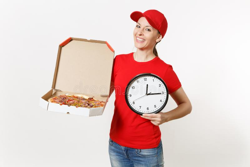 Delivery woman in red uniform isolated on white background. Pretty female in cap, t-shirt, jeans working as courier. Holding italian pizza in cardboard flatbox stock photos