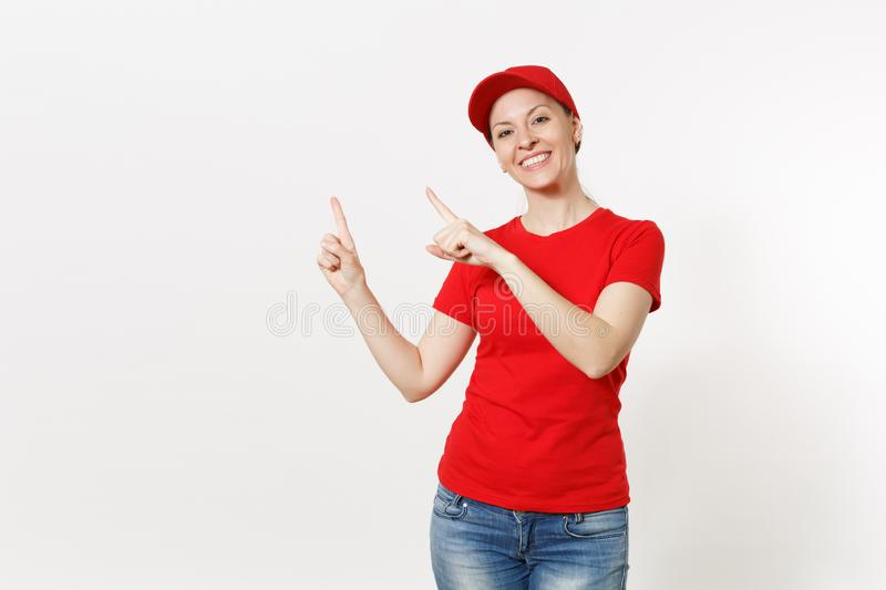 Delivery woman in red uniform isolated on white background. Professional caucasian female in cap, t-shirt, jeans working. As courier or dealer, pointing index royalty free stock photos