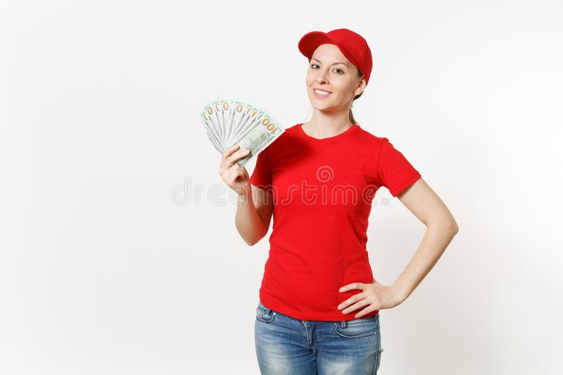 Delivery woman in red uniform isolated on white background. Professional female in cap, t-shirt, jeans working as. Courier or dealer, holding bundle of dollars stock photo