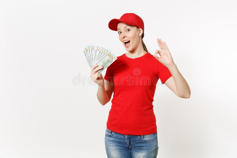 Delivery woman in red uniform isolated on white background. Professional female in cap, t-shirt, jeans working as. Courier or dealer, holding bundle of dollars royalty free stock photos