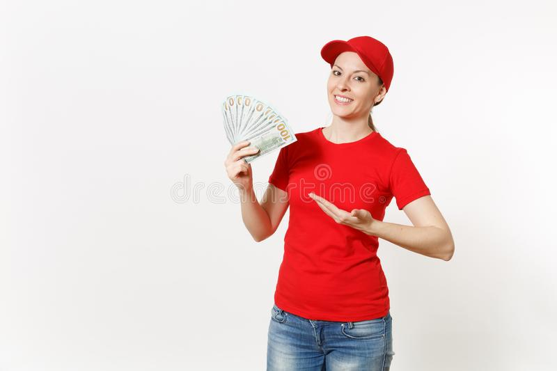 Delivery woman in red uniform isolated on white background. Professional female in cap, t-shirt, jeans working as. Courier or dealer, holding bundle of dollars royalty free stock photo