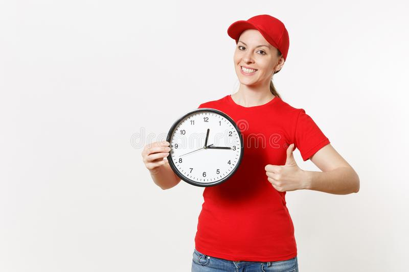 Delivery woman in red uniform isolated on white background. Professional female in cap, t-shirt, jeans working as. Courier or dealer, holding round clock stock photography