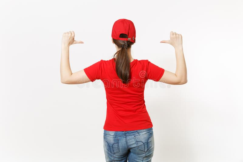 Delivery woman in red uniform isolated on white background. Professional pretty female in cap, t-shirt, jeans working as royalty free stock photography