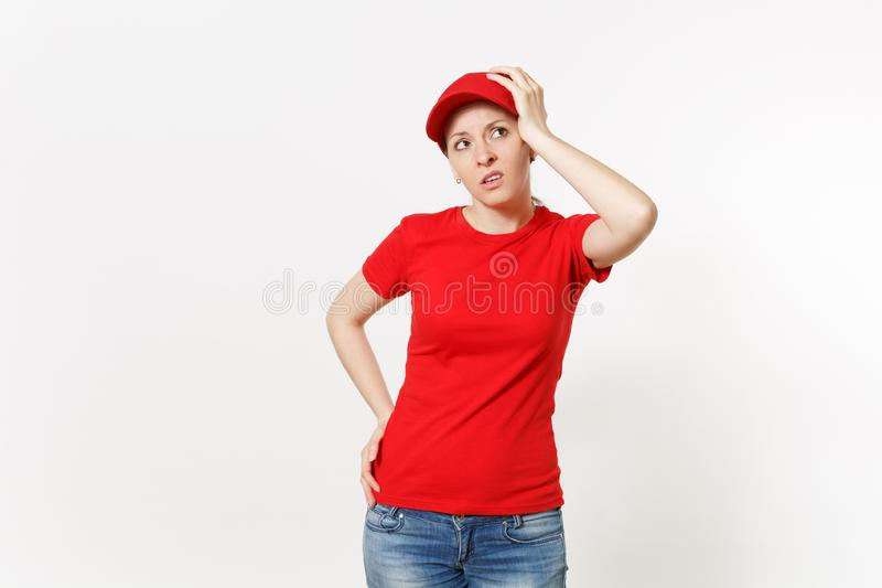 Delivery woman in red uniform isolated on white background. Professional shocked female in cap, t-shirt, jeans working. As courier or dealer, put her hand on royalty free stock images