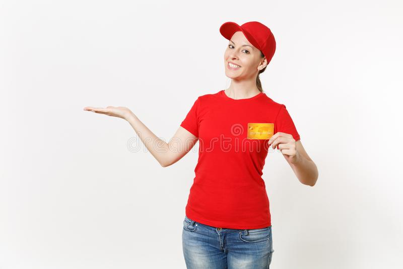 Delivery woman in red uniform isolated on white background. Professional smiling caucasian female in cap, t-shirt, jeans. Delivery woman in red uniform isolated stock images