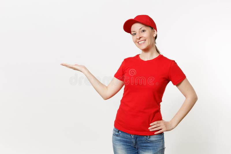 Delivery woman in red uniform isolated on white background. Professional smiling female in cap, t-shirt, jeans working. Delivery woman in red uniform isolated on stock photo