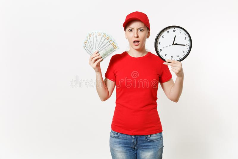Delivery woman in red uniform isolated on white background. Shocked female in cap, t-shirt, jeans working as courier or. Dealer, holding bundle odollars cash royalty free stock images