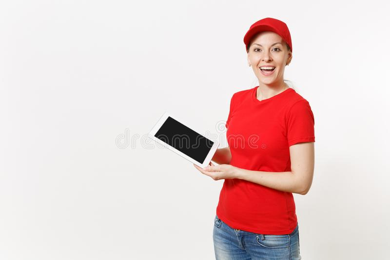 Delivery woman in red uniform isolated on white background. Smiling female in cap, t-shirt, jeans working as courier or. Delivery woman in red uniform isolated stock images