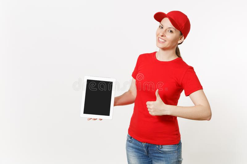 Delivery woman in red uniform isolated on white background. Smiling female in cap, t-shirt, jeans working as courier or stock photos
