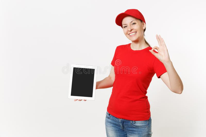 Delivery woman in red uniform isolated on white background. Smiling female in cap, t-shirt, jeans working as courier or. Delivery woman in red uniform isolated royalty free stock photos