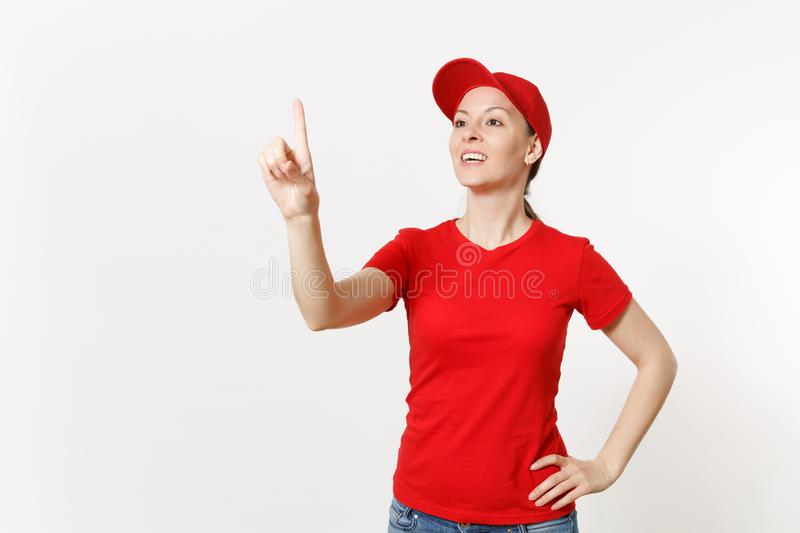 Delivery woman in red uniform touch something like click on button isolated on white background. Female in cap, t-shirt. Jeans working as courier or dealer stock images