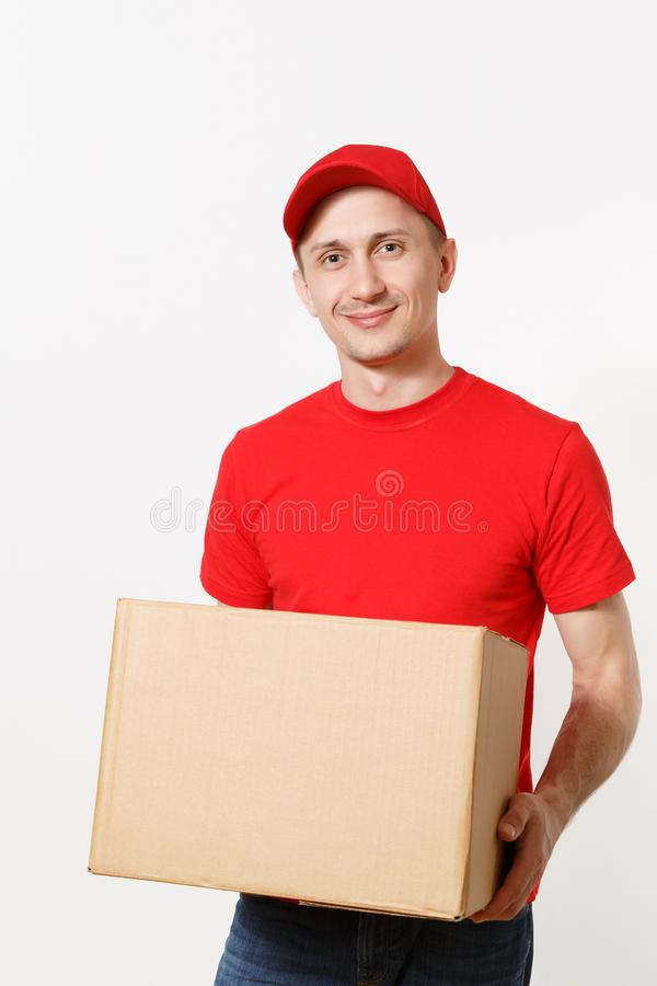Delivery young man in red uniform isolated on white background. Male in cap, t-shirt, jeans working as courier or dealer stock photo