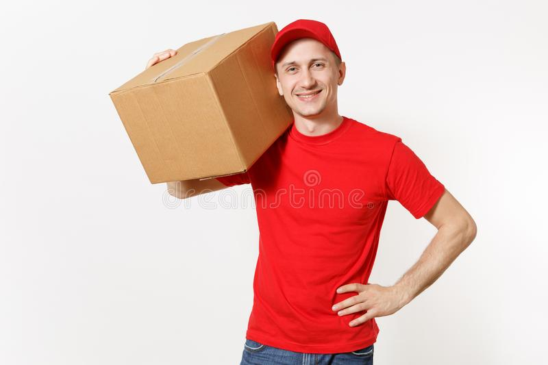 Delivery young man in red uniform isolated on white background. Male in cap, t-shirt, jeans working as courier or dealer. Holding empty cardboard box. Receiving royalty free stock photo