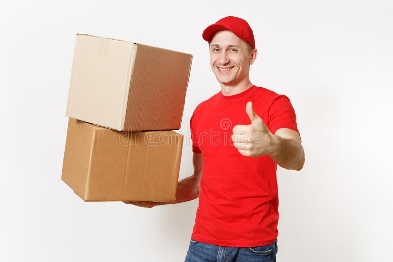 Delivery young man in red uniform isolated on white background. Male in cap, t-shirt, jeans working as courier or dealer. Holding empty cardboard boxes royalty free stock photography