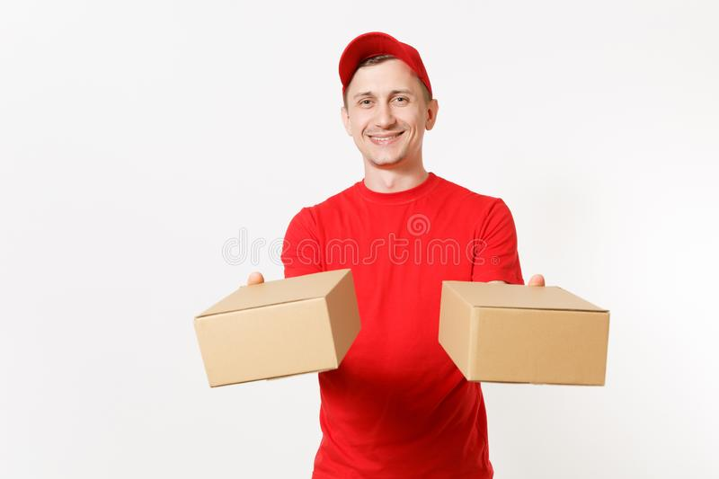 Delivery young man in red uniform isolated on white background. Male in cap, t-shirt working as courier or dealer. Holding two empty cardboard boxes. Receiving stock images