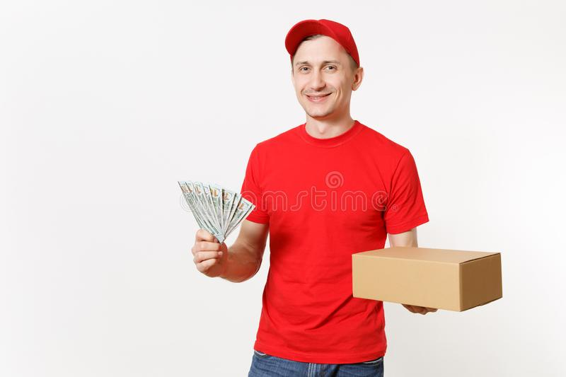 Delivery young man in red uniform isolated on white background. Male courier in cap, t-shirt holding bundle of dollars. Cash money, empty cardboard box stock image