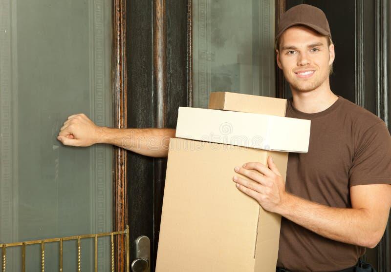 Deliveryman ocupado imagem de stock