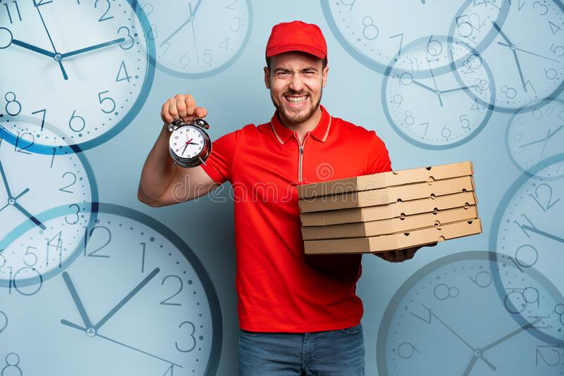 Deliveryman is punctual to deliver quickly pizzas. Cyan background royalty free stock images