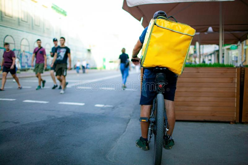 Deliveryman ride bicycle service, Fast and Free Transport Delivery. royalty free stock photo