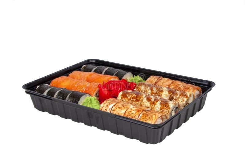 Delizioso saporito del rotolo di sushi dell'alimento dell'Asia sul bianco fotografie stock