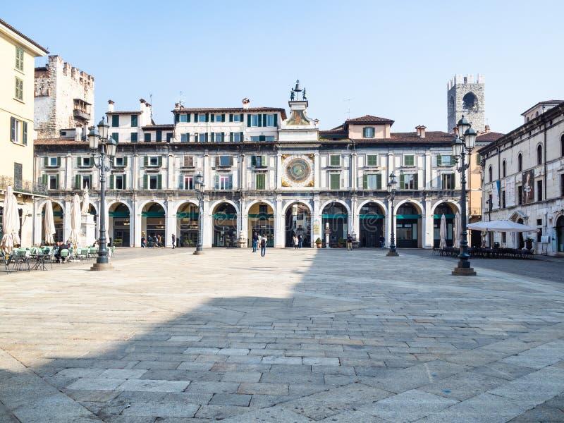 Dell 'Orologio de Torre en logia de la plaza en Brescia imagen de archivo