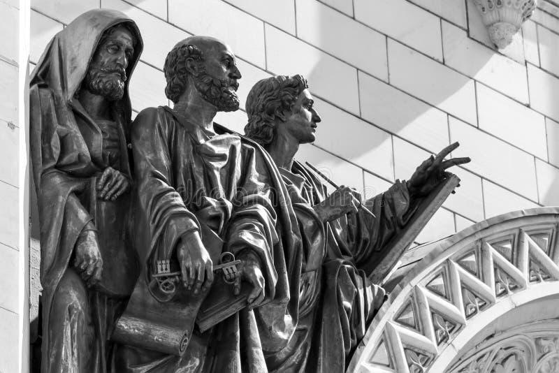 Dell'apostolo Peter della st e di due evangelisti fotografie stock