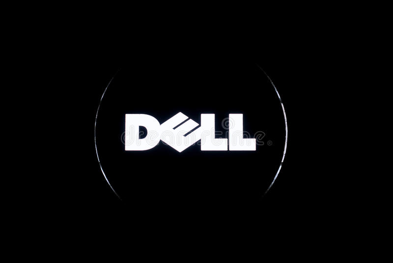 Dell logo. Dell computer logo illuminated, from the back of an XPS laptop