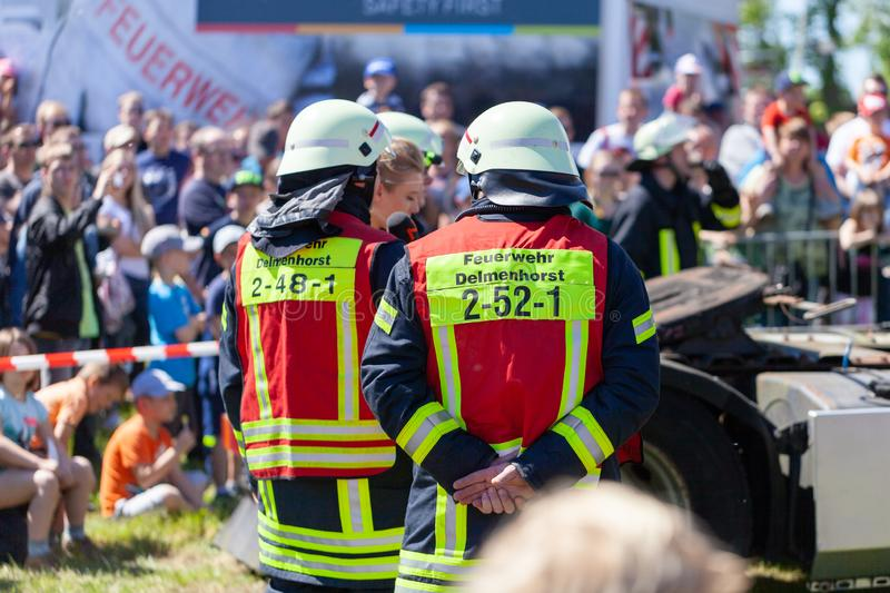 German firefighters  train on a truck accident. DELMENHORST / GERMANY - MAY 6, 2018: German firefighters  train on a truck accident at an open day. Feuerwehr stock photos