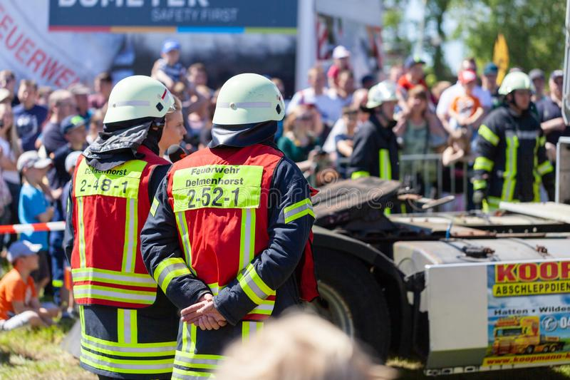 German firefighters  train on a truck accident. DELMENHORST / GERMANY - MAY 6, 2018: German firefighters  train on a truck accident at an open day. Feuerwehr royalty free stock photography