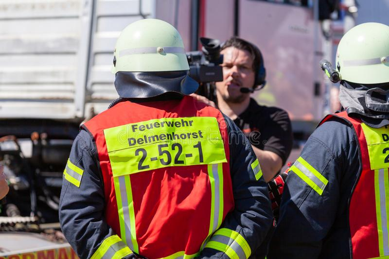 German firefighters  train on a truck accident. DELMENHORST / GERMANY - MAY 6, 2018: German firefighters  train on a truck accident at an open day. Feuerwehr stock image