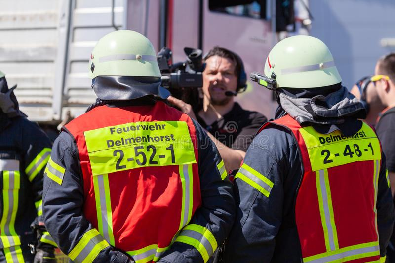 German firefighters  train on a truck accident. DELMENHORST / GERMANY - MAY 6, 2018: German firefighters  train on a truck accident at an open day. Feuerwehr royalty free stock image