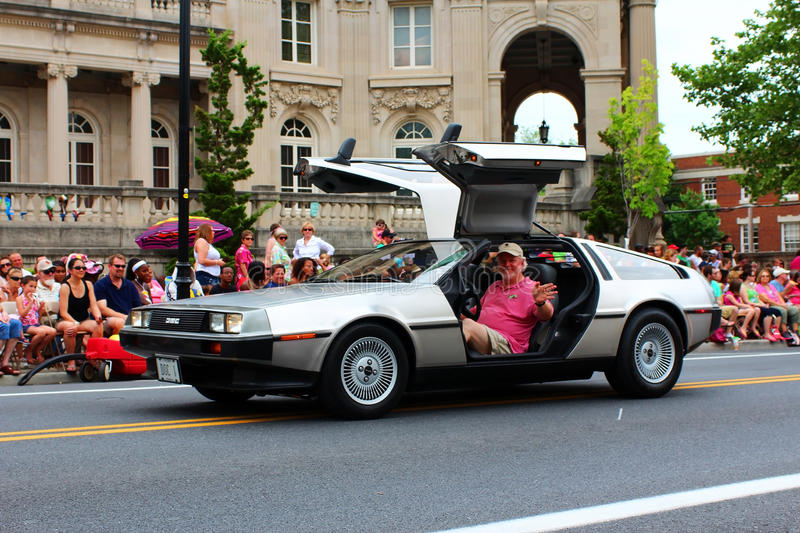 DeLorean in Festival Parade. DeLorean DMC-12 in the Apple Blossom Festival Grand Feature parade on May 5, 2012 with gull-wing doors fully opened. Photographed in stock photos