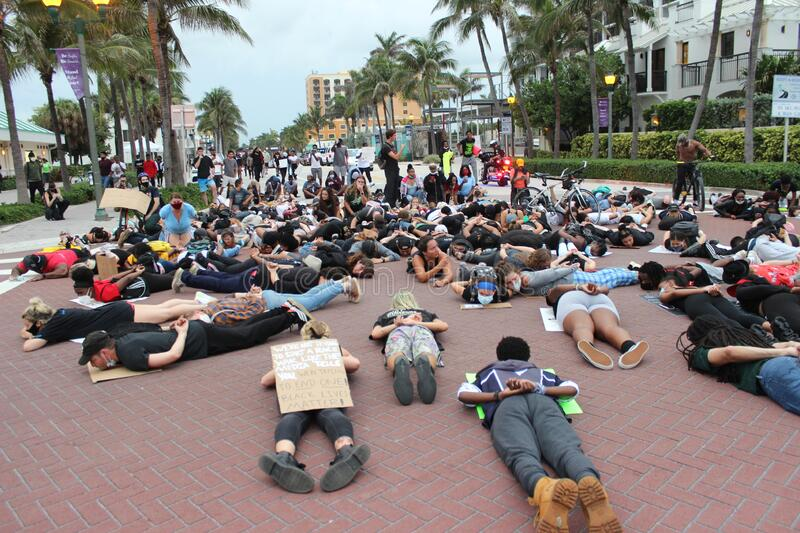 Protesting the death of George Floyd in Delray Beach, Florida. DELRAY BEACH, FL- JUNE 03: Protestors lay on the ground with their hands behind their back in a stock images
