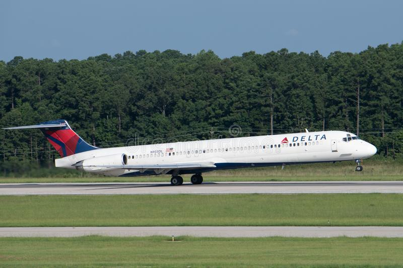 Delta Air Lines McDonnell Douglas MD-88 takes off. Raleigh, NC / August 12, 2018: A Delta Air Lines McDonnell Douglas MD-88 takes off from Raleigh-Durham stock images