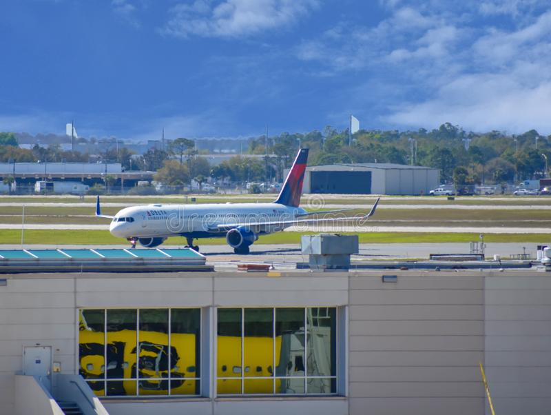Delta aircraft on runway preparing for departure from the Orlando International Airport MCO. stock photography