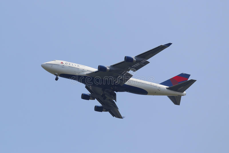 Delta Airline Boeing 747 approaching JFK Airport. NEW YORK - AUGUST 10: Delta Airline Boeing 747 approaching JFK Airport on August 10, 2014. The Boeing 747 is a royalty free stock photo