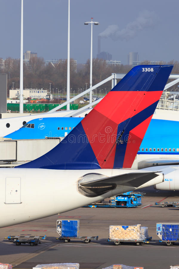 Delta Airlines tail. Tail of Delta Airlines jet with logo, with Skyteam Alliance partner KLM in background royalty free stock photography