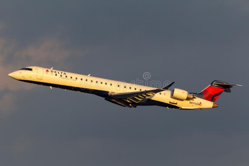 Delta Connection Bombardier CRJ-900LR regional airliner aircraft departing McCarran International Airport in Las Vegas. Las Vegas, Nevada, USA - May 9, 2013 royalty free stock images