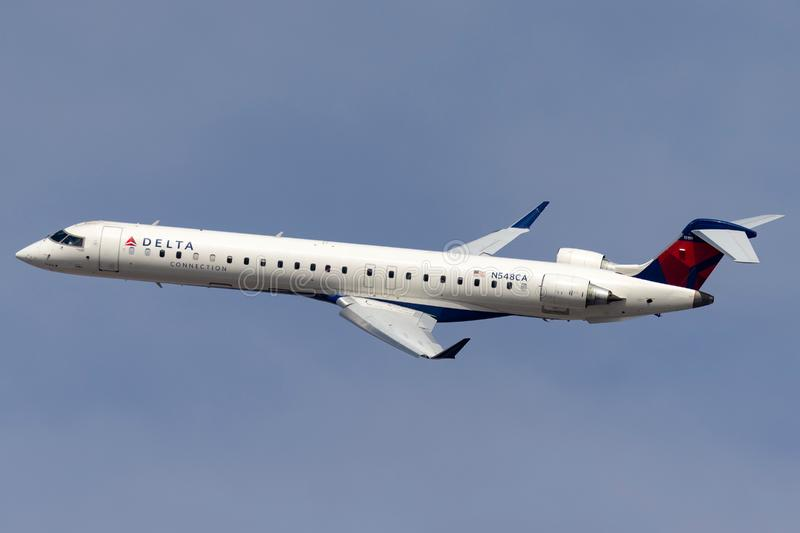 Delta Connection Bombardier CRJ-900LR regional airliner aircraft departing McCarran International Airport in Las Vegas. Las Vegas, Nevada, USA - May 8, 2013 royalty free stock photo
