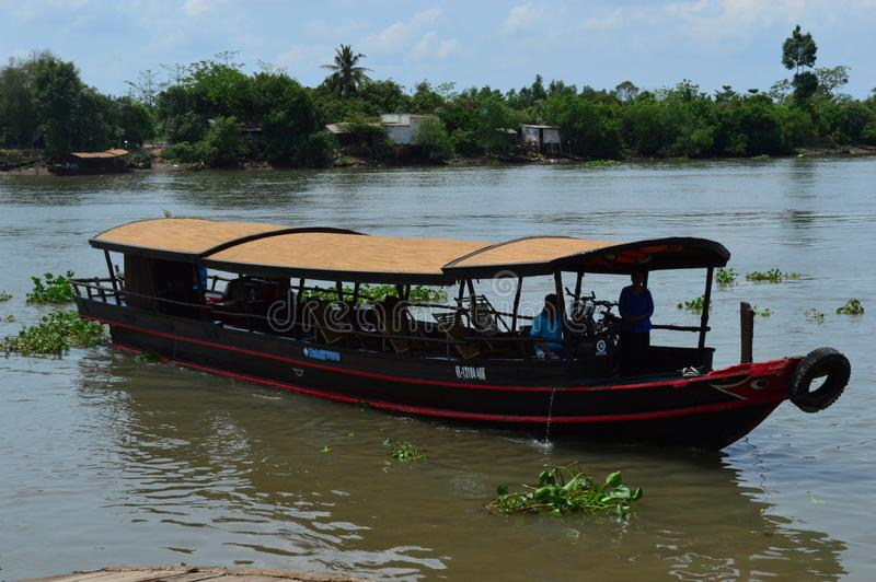 Delta de Vietname - de Mekong - barco do cruzeiro do rio imagens de stock