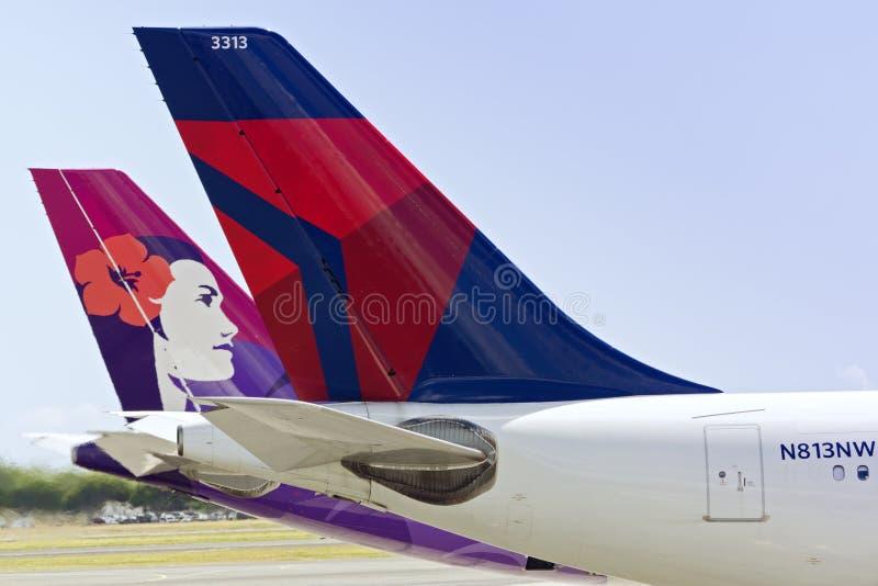 Delta et avions à réaction de Hawaiian Airlines photo libre de droits