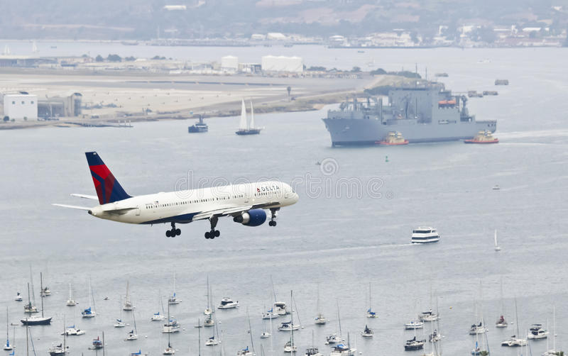 A Delta Jet on Approach Over San Diego Bay stock photo