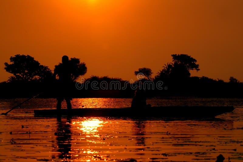 Delta okavango日落 免版税图库摄影