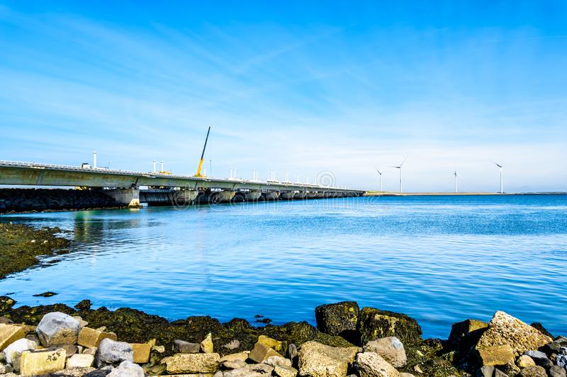 The Delta Works Storm Surge Barrier and Wind Turbines at the Oosterschelde viewed from Neeltje Jans island royalty free stock image