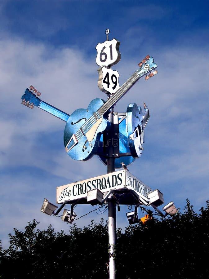 Deltan slösar gitarrhuvudvägtecknet royaltyfri fotografi