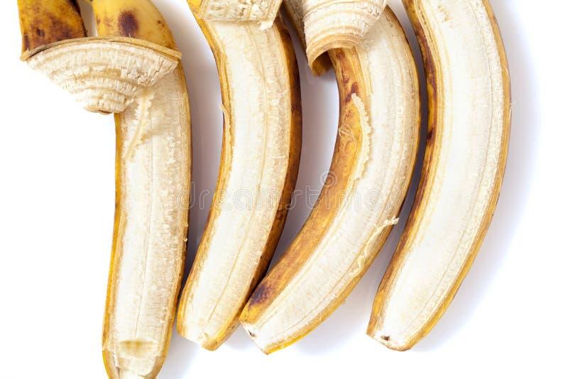 Delvis skalad lögn för banan fyra i horisontalrad royaltyfria foton